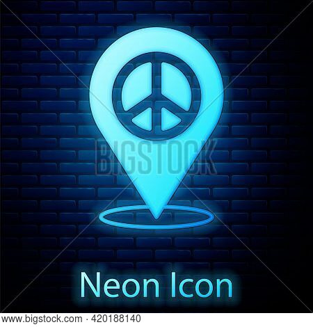 Glowing Neon Location Peace Icon Isolated On Brick Wall Background. Hippie Symbol Of Peace. Vector