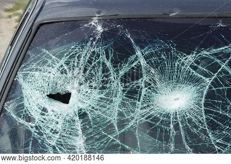 Cracks On The Broken Windshield Of A Car After An Accident.