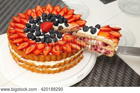 Strawberry Cake With Whipped Cream.piece Cut From The Cake. Homemade Cake. High Quality Photo