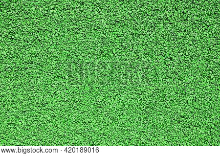 Green Grain Texture. Small Rocks In Strong Sunlight. Abstract Grain Background. Tarmac Surface Athle