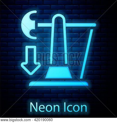 Glowing Neon Drop In Crude Oil Price Icon Isolated On Brick Wall Background. Oil Industry Crisis Con