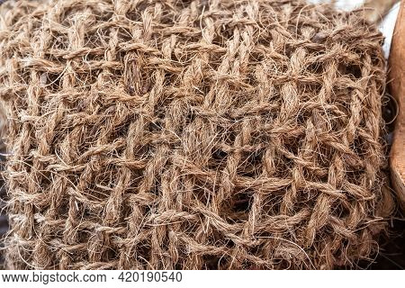 Knitted Net Made Of Coconut Fiber. Coconut Fiber Is A Material Derived From The Shell Of A Coconut.