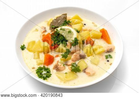 Traditional Finnish Salmon Soup. White Background. Healthy Food. High Quality Photo
