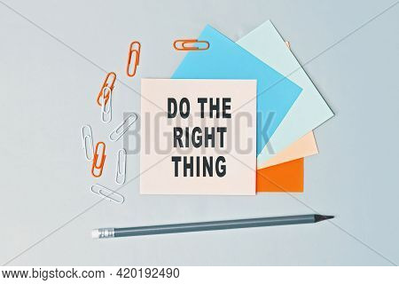 Do The Right Thing - Text On Sticky Note Paper On Gray Background. Closeup Of A Personal Agenda. Top