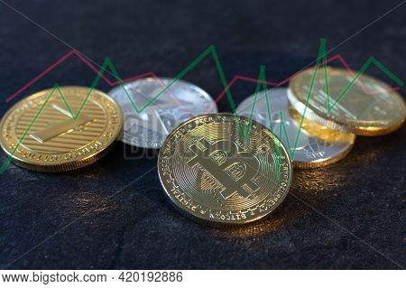 Various Cryptocurrency Coins With Bitcoin In The Center On Black Background. Cryptocurrency, Virtual