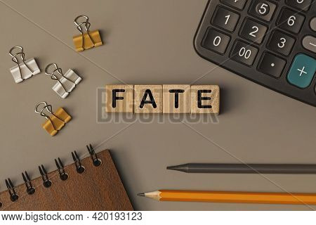 Word - Fate - On Small Wooden Blocks On The Desk. Conceptual Photo. Top View