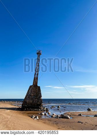 Beautiful Sea Beach With Dune Sand And An Old Abandoned Lighthouse. The Lighthouse Is Based On Large