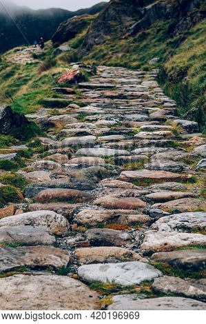 Close Up Of Stone Path Of Miners Tack In Snowdonia National Park In North Wales, Uk. Shoot During Gl