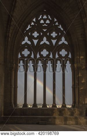Lleida, Spain, May 1, 2020 - Rainbow In Typical Gothic Window Of La Seu Vella Cathedral. Cloister Pa