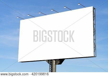 Blank Big Billboard Against Blue Sky Background. White Horizontal Board Mock Up For Advertising, Mar
