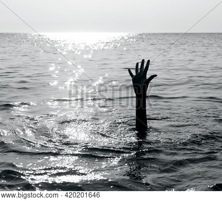 Dramatic Black And White Scene With The Hand Of The Castaway Who Is About To Drown In The Middle Of