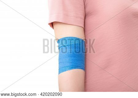 Elastic Bandage On The Elbow Joint Of The Girl. Elbow Fixation Concept For Sprains And Trauma, Copy