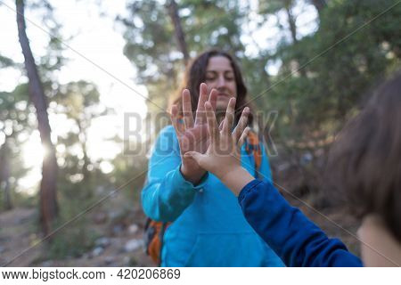 Girl Giving High Five To Child, Greeting Gesture, Woman Walking In The Woods, Girl Met A Friend In T