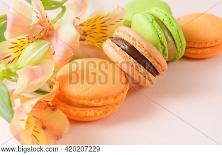 Macaroons, Beige, Green,  Peach,  French Cookies With Flowers On A Beige  Background