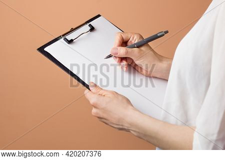Psychologist Writing Notes Or Prescription During Therapy Session. Doctor Hold Clipboard Psychothera