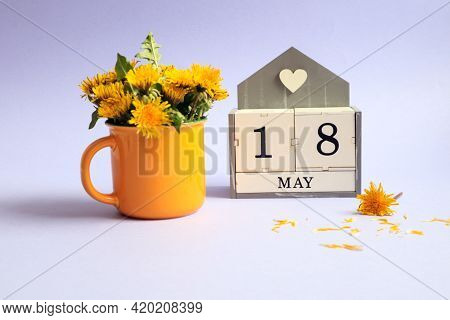 Calendar For May 18: Cubes With The Number 18, The Name Of The Month Of May In English, A Bouquet Of
