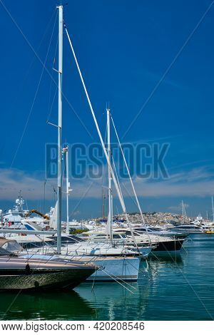 Yachts and boats moored on summer day in port of Athens. Athens, Greece