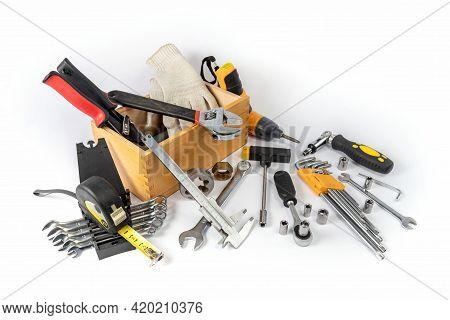Wooden Tool Box On White Background. Tools For Repair Work. Construction Tools And Hoists Are In The
