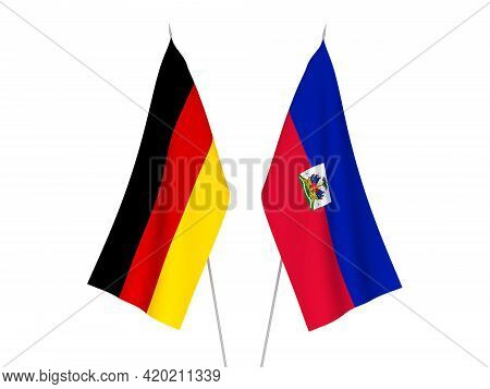 National Fabric Flags Of Germany And Republic Of Haiti Isolated On White Background. 3d Rendering Il