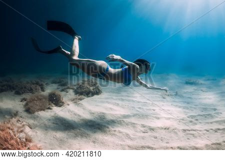 Attractive Freediver Woman With Fins Dive At Deep Underwater In Sea.