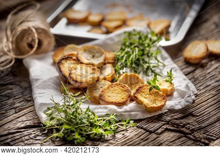 Crispy Goldish Bake Rolls With Savory Flavour, Served With Lovely Green Thyme Tied By Flax Twine.