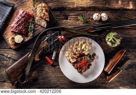 Rustic Wooden Table With A Raw Deer Venison, Delicious Homemade Dumpling And Rosemary. Between The P