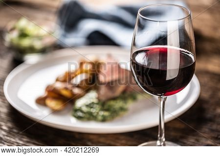 Red Wine As A Typical Baverage To A Red Meat Sous Vide Steak With Roasted Potatoes, Spinach Dip And