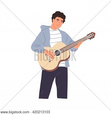 Young Musician Performing Music On Acoustic Guitar. Happy Guitarist Standing And Playing Romantic Me