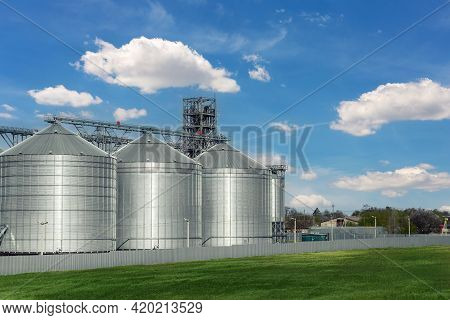 Scenic View Of Big Modern Steel Agricultural Grain Granary Silos Cereal Bin Storage Warehouse Agains