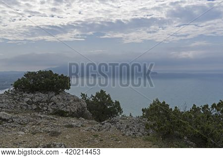 View From The Top Of Cape Alchac To Cape Meganom, Partially Hidden By Clouds. Sudak, Crimea. Cloudy,