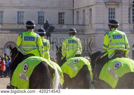 LONDON, UK - CIRCA APRIl 2011: Four mounted police officers at Horse Guard Parade.