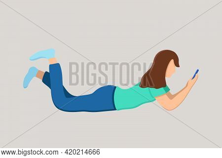 A Young Brunette Girl Is Lying On Her Stomach With A Phone In Her Hands. Communication By Phone, Fre