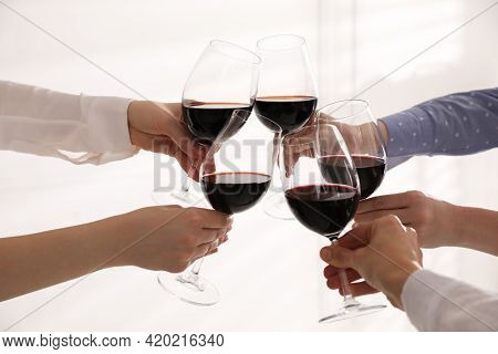 People Clinking Glasses Of Wine On White Background, Closeup