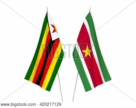 National Fabric Flags Of Zimbabwe And Suriname Isolated On White Background. 3d Rendering Illustrati
