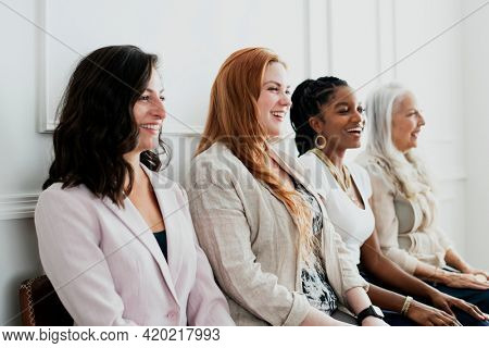 Happy gorgeous women sitting together