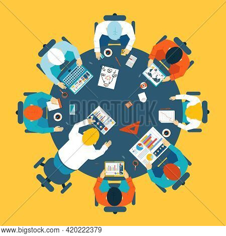Brainstorming And Teamwork Concept With A Broup Of Busdinessman Having A Meeting Around A Round Tabl