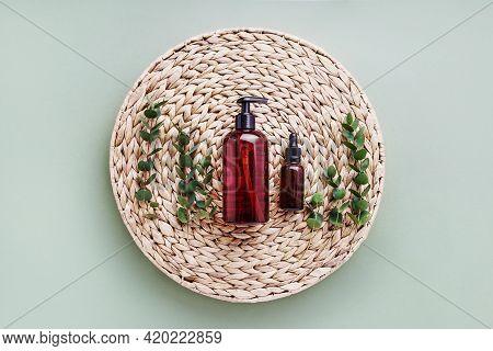 Dropper Bottle Of Essential Oil Or Serum, Eucalyptus And Dark Dispenser Bottle Of Shower Gel, On Rat