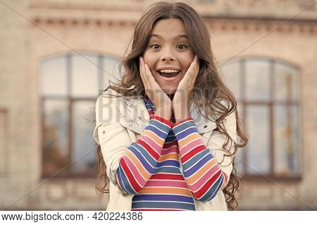 Surprised Little Girl Has Trendy Look. Casual Hipster Lifestyle. Beauty And Fashion. Her Perfect Hai
