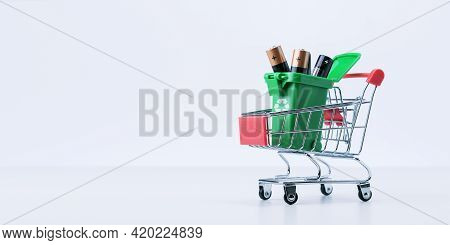 Collection And Recycling Concept Used Batteries. Used Batteries In Garbage Container  In Trolley. Ba