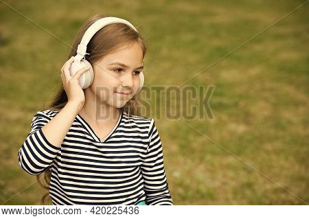 Language Is New Life. Little Child Wear Headphones Summer Outdoors. English School. Language Educati