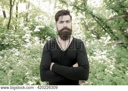Stylish And Comfortable. Serious Stylish Hipster On Summer Outdoor. Bearded Man With Stylish Hair We