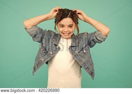 Shape Your Braids Into Gorgeous Hairstyle. Happy Child Wear Braided Hairstyle Blue Background. Hair