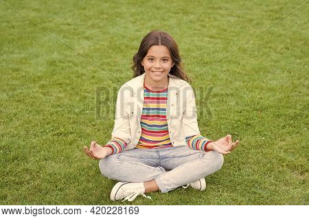 Peace Of Mind. School Break For Rest. Adorable Pupil. Girl Kid Sit On Lawn. Girl School Uniform Enjo