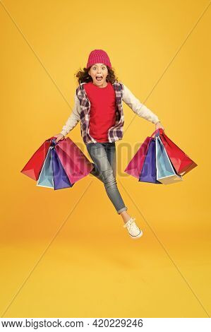 Hurry Up, Sale Ends. Energetic Kid Carry Shopping Bags. Emotional Shopper Haste Yellow Background. C