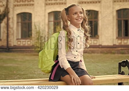 Knowledge Is Light. Happy Child On September 1. Knowledge Day. Little Girl Carry School Backpack. Ed