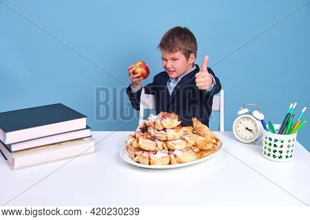 Schoolboy Junior Chooses The Right Healthy Food Showing Hand Gesture Thumbs Up