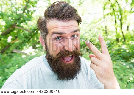 Brutal Male Leisure. Summer Fun. Bearded Guy In Park Forest. Bearded Hipster. Hipster With Long Bear