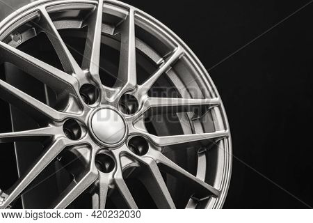 Sporty Lightweight Alloy Wheel, Spokes And Rim Close-up On A Black Background