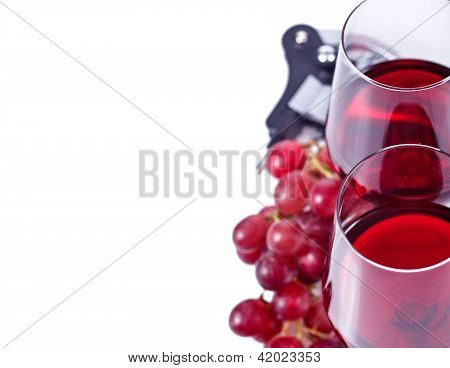 Wine Glasses With Red Wine And Grapes With A Copy Space On The Left