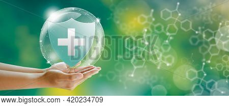 Hand Offer Medical Shield On Green Background With Butterfly And Chemical Formulas. Family Life Insu